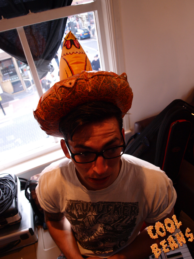 Ben trying out the chicken hat look.
